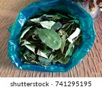 Small photo of Coca leaves in a blue plastic bag, Used in countries like Peru and Bolivia to combat altitude sickness.