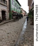 Small photo of Calle Crisologo or Mena Crisologo street after the rain, Vigan, Philippines (24 July 2015)