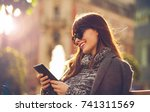 smiling woman using tablet or... | Shutterstock . vector #741311569