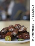 Small photo of Chicken wings are a popular dish in hawker centres across Singapore
