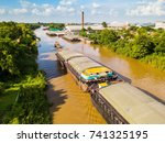 Aerial View Of Barges With...