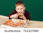 children eat italian pizza in...   Shutterstock . vector #741327085