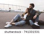 pensive couple in casual...   Shutterstock . vector #741331531