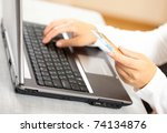 hands holding credit card and...   Shutterstock . vector #74134876