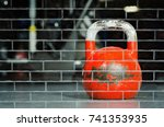 Red Kettlebell On The Gym Floo...
