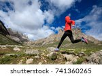 young woman trail runner... | Shutterstock . vector #741360265