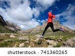 young woman trail runner... | Shutterstock . vector #741360265