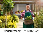 man working in garden center  | Shutterstock . vector #741389269