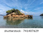 small island on s'illot beach ... | Shutterstock . vector #741407629