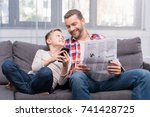 smiling father with newspaper... | Shutterstock . vector #741428725