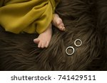 Small photo of Wedding Ring with baby