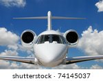 Private Jet Against Blue Sky...