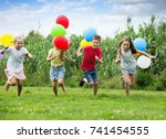 four small kids happily playing ... | Shutterstock . vector #741454555