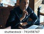 business man thinks  cafe       ... | Shutterstock . vector #741458767