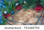 Small photo of Christmas and New Year wooden background with fir tree acerose, red rowan berries, blue and silver balls and garland ornament decoration, copy space