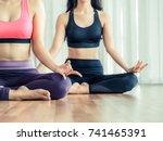 women practicing yoga pose in... | Shutterstock . vector #741465391