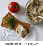 Homemade chicken or fish spread on cracker - stock photo
