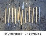 Small photo of Different tools for qualitative cleaning of finds in archeology, paleontology and geology