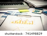 business report and chart on... | Shutterstock . vector #741498829