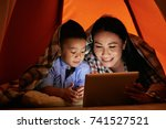 little boy and his mother lying ... | Shutterstock . vector #741527521