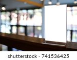 mock up menu frame standing on... | Shutterstock . vector #741536425