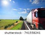 truck transportation at sunset | Shutterstock . vector #741558241