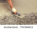 hand builder with trowel... | Shutterstock . vector #741560611