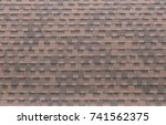 close up on brown roof shingles ... | Shutterstock . vector #741562375