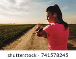 athletic woman preparing run on ...   Shutterstock . vector #741578245