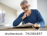 middle aged man at home... | Shutterstock . vector #741581857