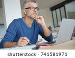 middle aged man working on... | Shutterstock . vector #741581971