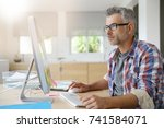 web designer working in office... | Shutterstock . vector #741584071