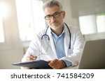 doctor in office working on... | Shutterstock . vector #741584209