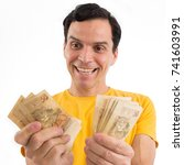 very happy man is holding lots... | Shutterstock . vector #741603991