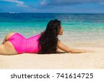 beautiful brunette on the shore ... | Shutterstock . vector #741614725