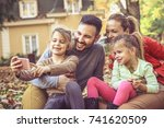 happy family take a self... | Shutterstock . vector #741620509