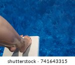 diving off diving board. | Shutterstock . vector #741643315