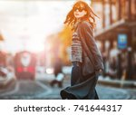 trendy fashion woman in coat... | Shutterstock . vector #741644317