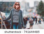 pretty styled woman in coat... | Shutterstock . vector #741644485