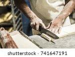 hands of the teacher baker in...   Shutterstock . vector #741647191