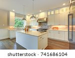 Stock photo amazing kitchen design with white shaker cabinets paired with marble counters large kitchen 741686104