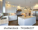 Stock photo amazing kitchen design with white shaker cabinets paired with marble counters large kitchen 741686227