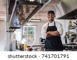 chef with his arms crossed... | Shutterstock . vector #741701791