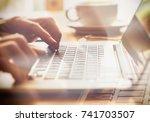a closeup of an office worker... | Shutterstock . vector #741703507