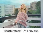 beautiful blond girl with red... | Shutterstock . vector #741707551