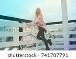 beautiful blond girl in the big ...   Shutterstock . vector #741707791