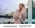 beautiful girl in the city and...   Shutterstock . vector #741707797