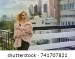 beautiful girl in the cold city ...   Shutterstock . vector #741707821