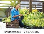 woman working in garden center  | Shutterstock . vector #741708187