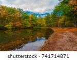 a trail winds around a lake... | Shutterstock . vector #741714871